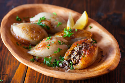 Try buying the largest onions you can find Lebanese Roasted Stuffed Onions Recipe