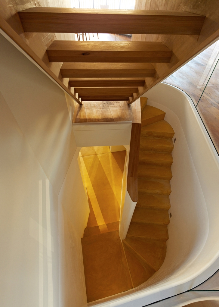 Wooden narrow stairs in Lavender Bay Boatshed by Stephen Collier Architects