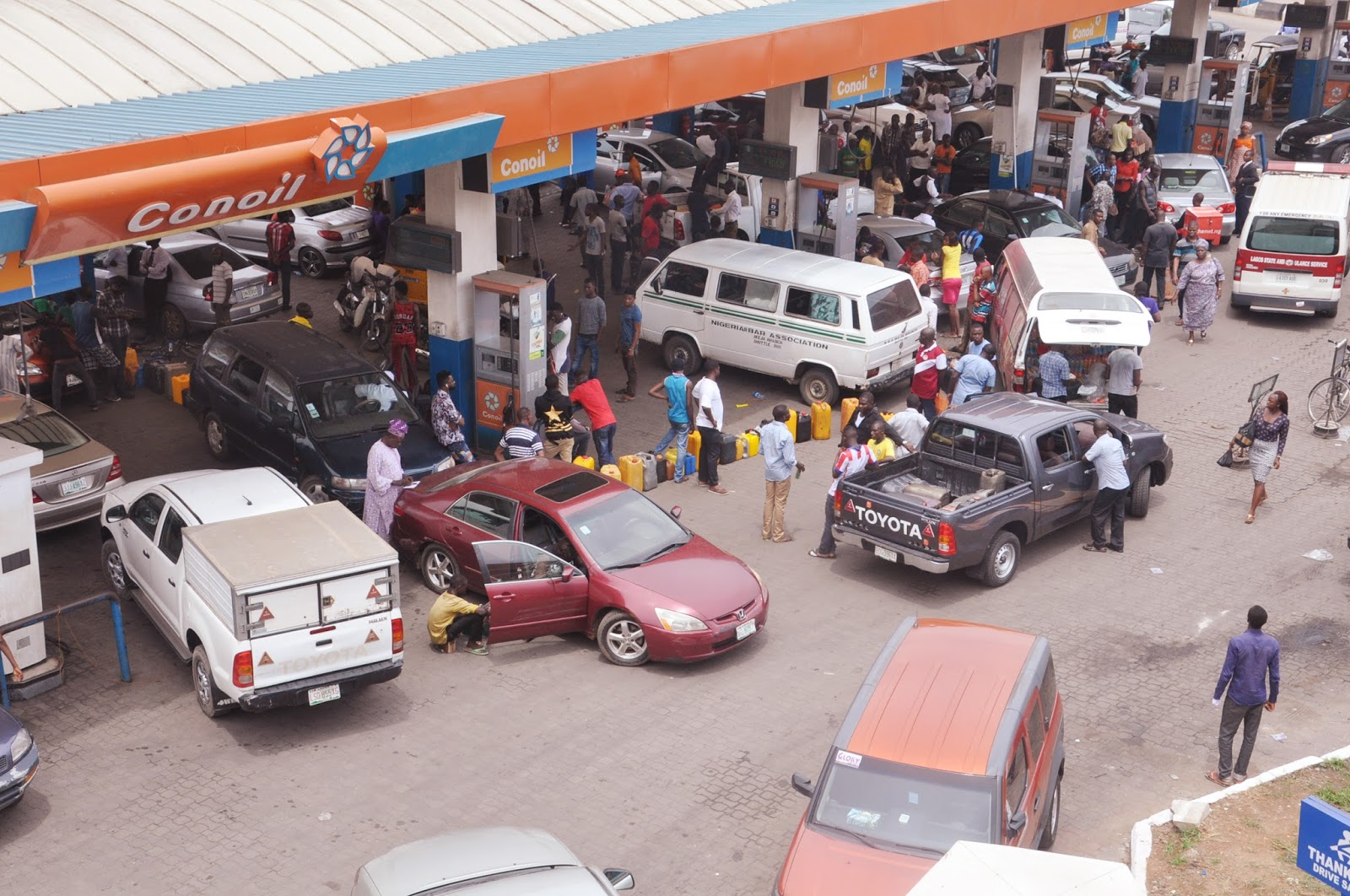 Image result for Scarcity: DPR monitors sales, seals off filling station in Lagos