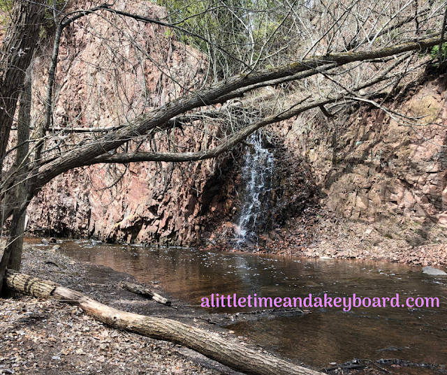 Small waterfall trickling down a rock bed at Congdon Park in Duluth, Minnesota