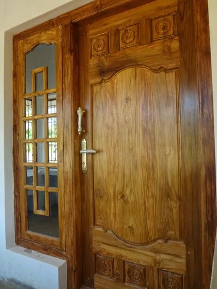 Kerala Model Front Door Design wood work Kerala Style ...