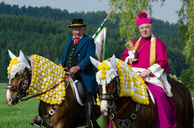 Cardinal Müller on a horse
