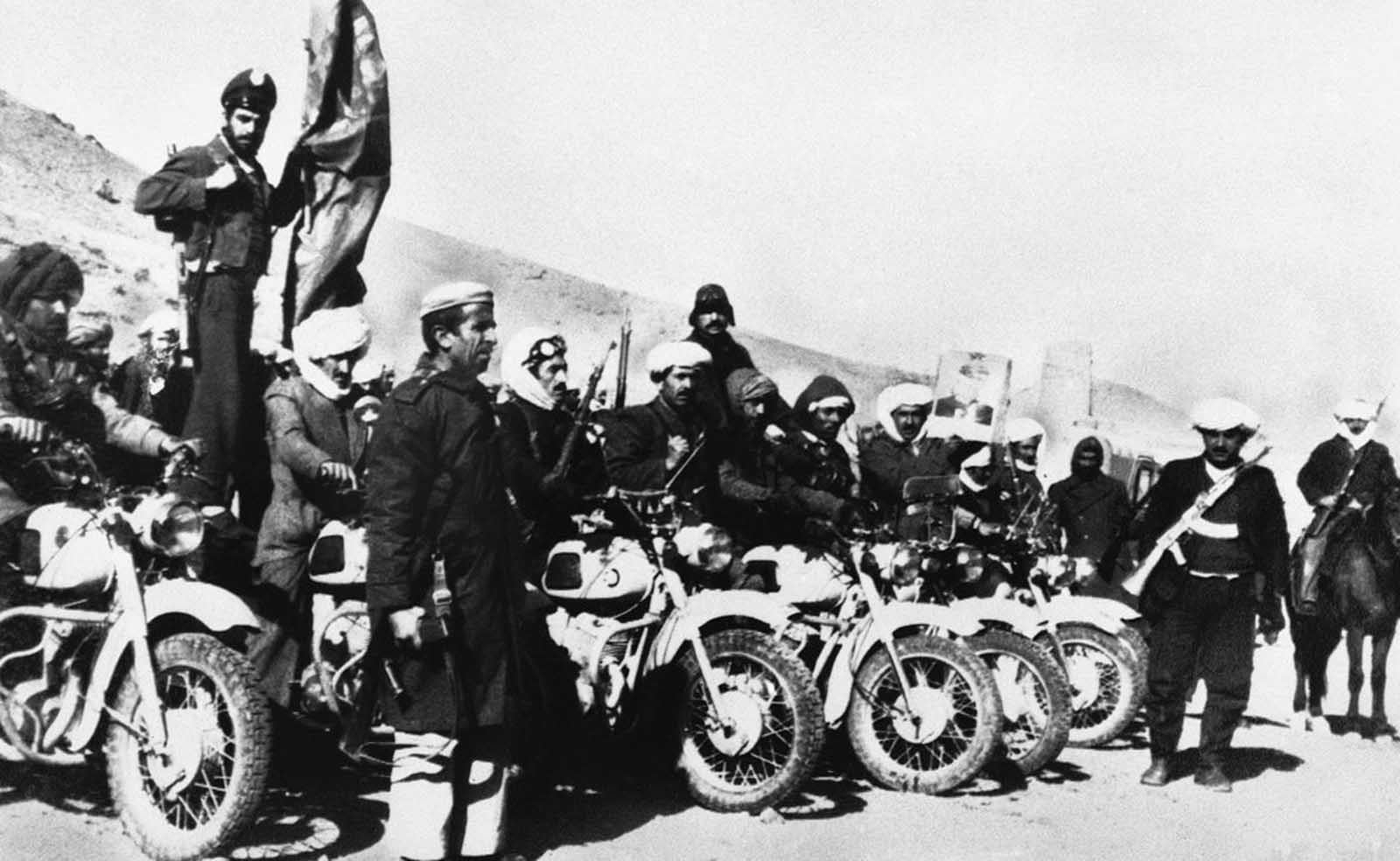 Afghan guerrillas, armed and equipped with motorcycles prepare for action with Soviet and government forces, in the mountainous western region of Afghanistan on January 14, 1980. The guerrillas were able to slip in and out of neighboring Iran, where they re-supplied from Muslims who sympathized with their struggle.