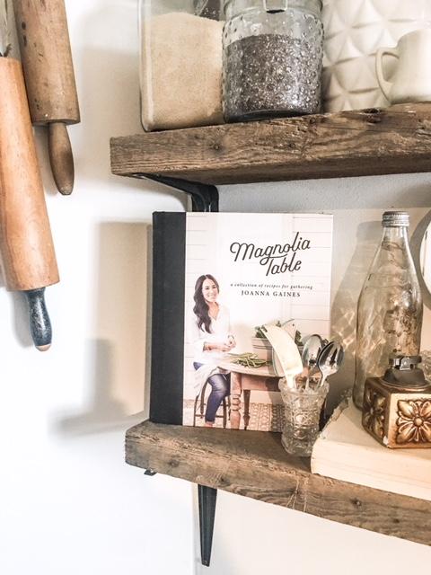 magnolia table book as decor