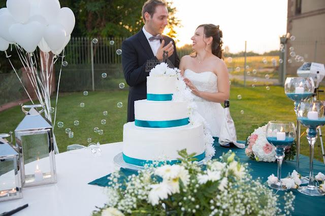 Allestimento tavolo torta nuziale lanterne e candele
