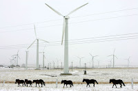 Slow-wind Winter: This Inner Mongolia wind farm was built to serve populations to the east. But in winter, wind power is curtailed in favor of coal power, which provides heat as well. (Photo Credit: China Photos/Getty Images) Click to Enlarge.