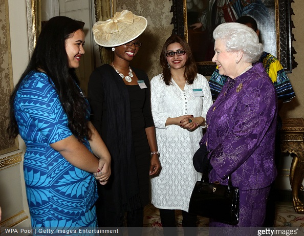 Queen Elizabeth II speaks with guests during a reception to mark Commonwealth Day at Marlborough House