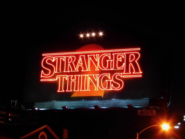 Stranger Things 2 neon sign billboard nighttime