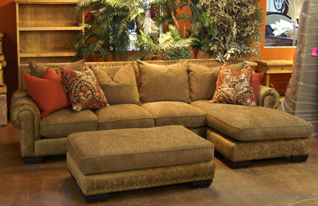 classy bright brown couch with chaise also square table along with some indoor plants in the corner of room