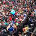 Migrantes rompen cerca y cruzan a territorio mexicano