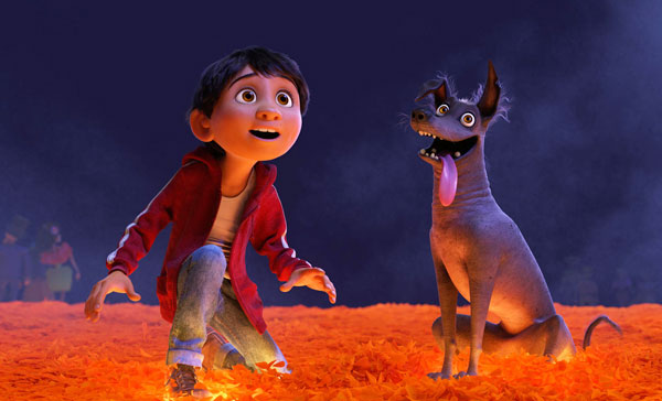 Miguel (voiced by Anthony Gonzalez) and his pet dog, Dante in COCO (2017)