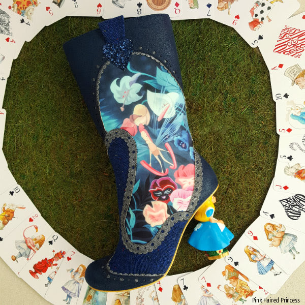 left boot lying on grass showing flowers scene from Disney Alice movie