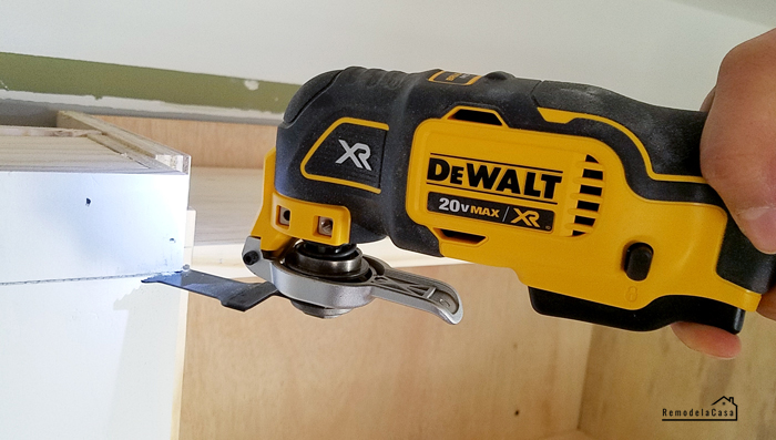 DeWalt Oscillating tool trimming top of shelves
