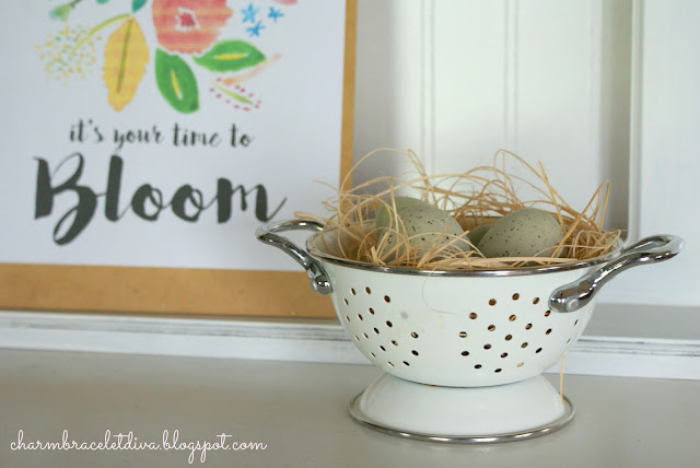 enamelware colander used as bird egg nest