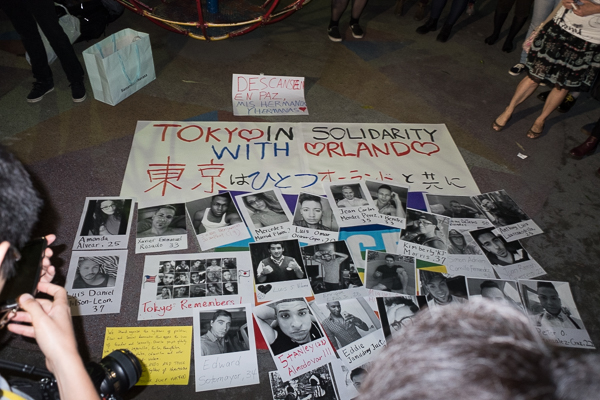 """Tokyo in solidarity with Orlando"": commemorative posters at candlelight vigil for Pulse nightclub shooting victims, in Shinjuku, Tokyo, Japan."
