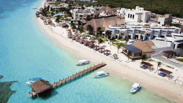 Immerse yourself in a high-end Caribbean escape at The Fives Azul Beach Resort Playa del Carmen, on Mexico's turquoise Caribbean coast.