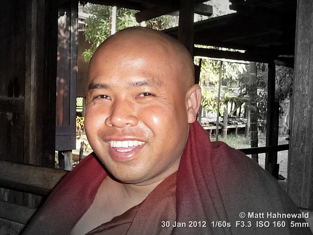 Burma, Myanmar, Inle Lake, grinning Burmese monk, Burmese man, people, street portrait, fat Buddhist monk, maroon robe, focal black and white