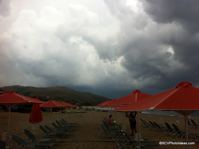 Dark gray clouds overcasting Skala-beach II