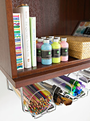 Home office organizing hacks. organize with a wine rack. Attaching under the shelf wine or stemware racks to a wall bookshelf, gives you more room for those everyday supplies. Simply insert glass cylinders in the racks then fill with pens, pencils, markers, and even paint brushes.