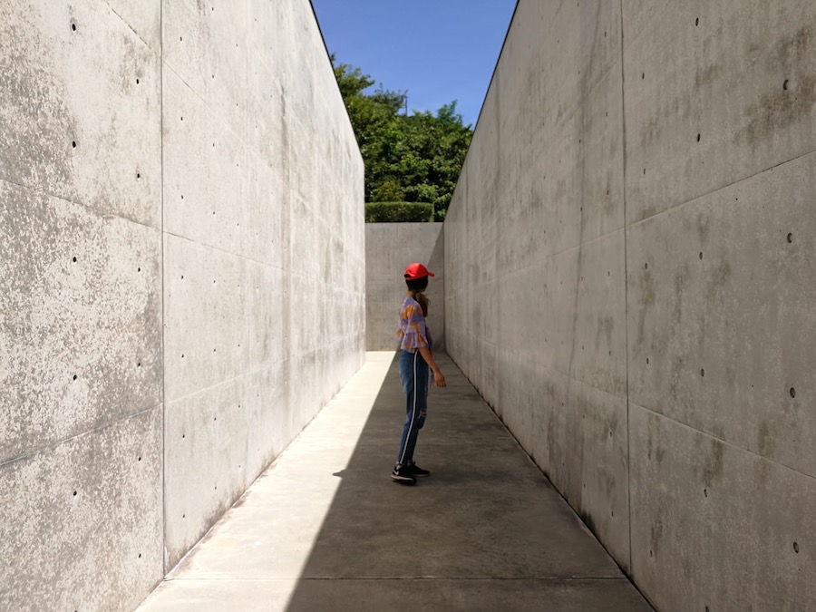 The tall cement walls of Lee Ufan Museum on Naoshima Island Japan