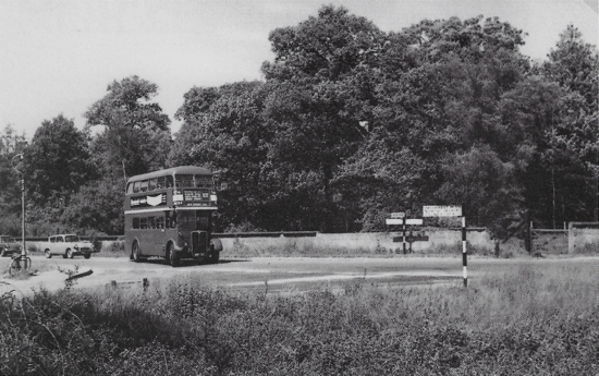 Photograph of Image 13a to source: Rookery junction, Marshmoor before the roundabout was built with a 303A bus turning in to Dixons Hill Road, July 1963