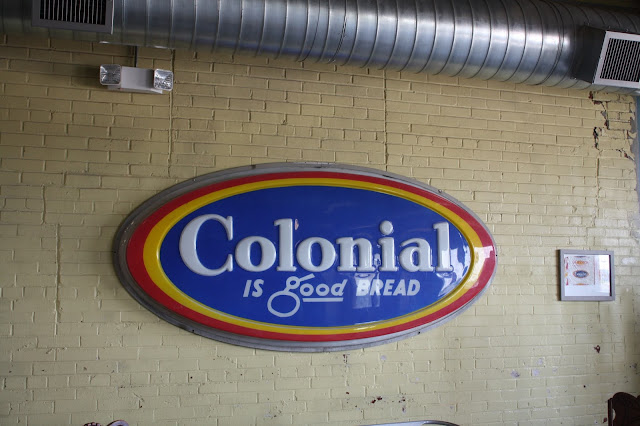 The Colonial Bakery sign is one of the historical elements in Old Bakery Beer Co