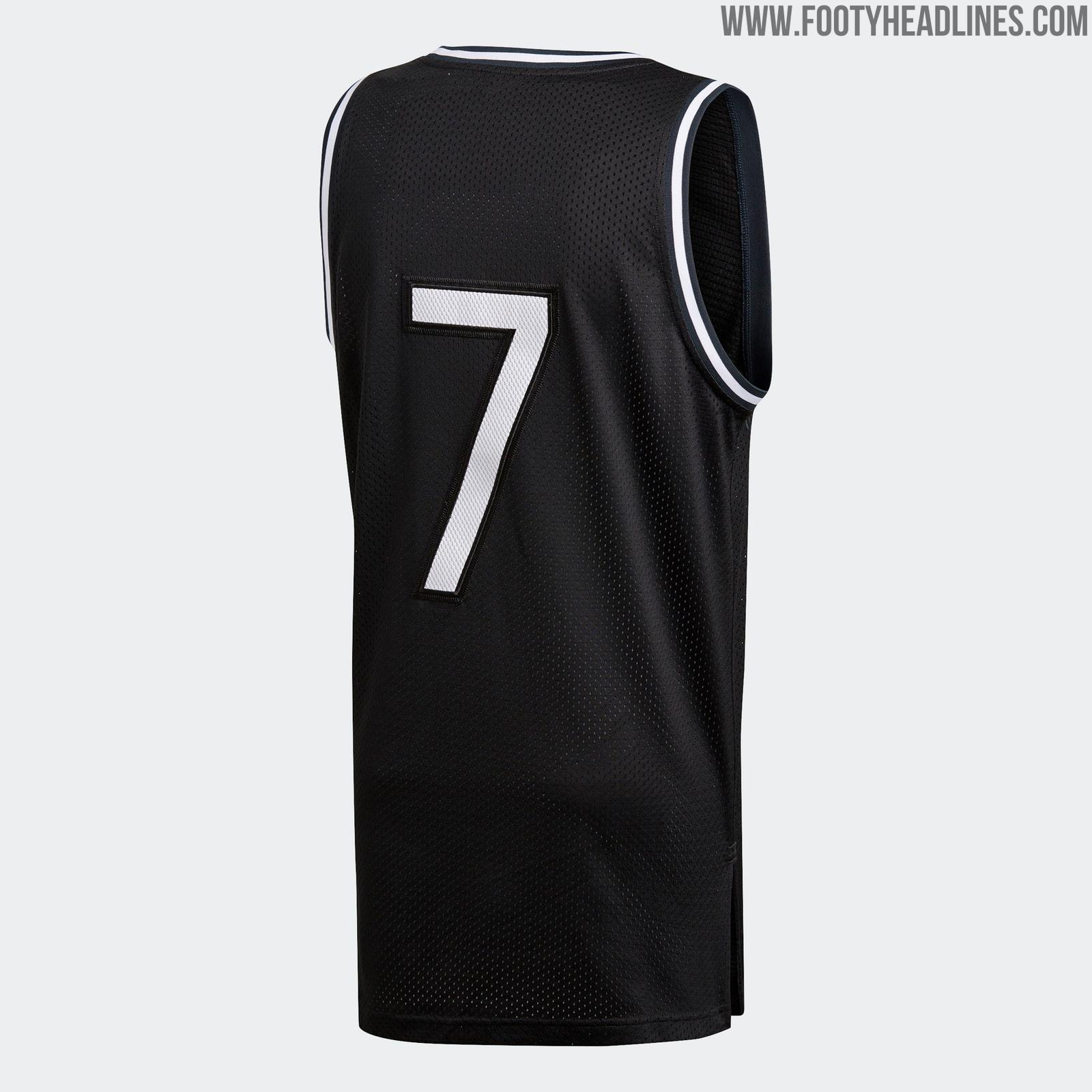 3fc1236002f The Adidas Real Madrid 18-19 basketball jersey   tank top is black with a  large