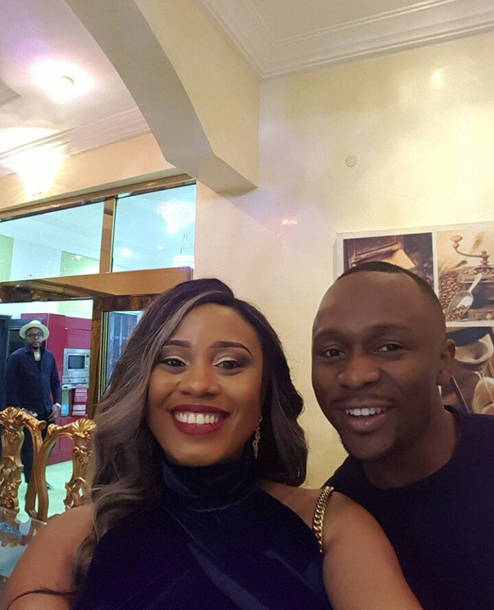E-money Frowns As Ushbebe Grabs His Wife For Selfie In Their Dining Room (Photo)