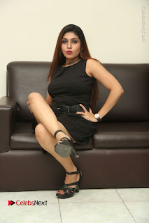 Tollywood Upcoming Actress Pooja Roshan Stills in Black Short Dress at Plus 1 Movie Trailer Launch  0291.JPG