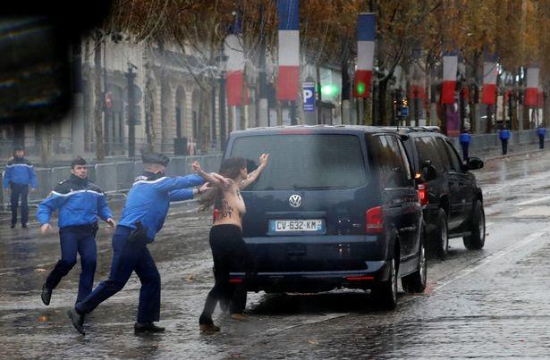 Photos &Video: Topless woman runs at President Trump's motorcade in Paris