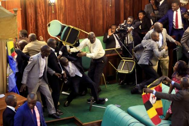 Photos: Mic stands, belts, chairs used as weapons as another fight erupts in Uganda's parliament; presidential guards, police arrest 27 MPs