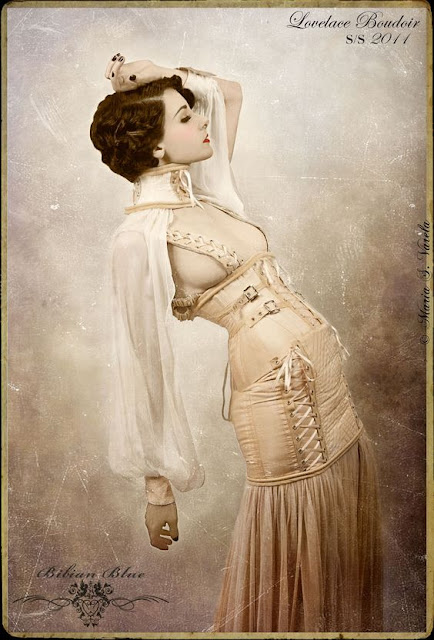 Women's neo-victorian clothing. This skirt/dress has a corset skirt and neck collar with attached sleeves, in ivory/ white