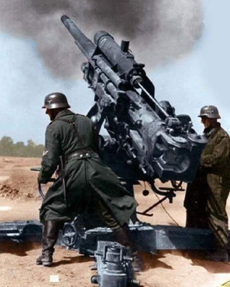German 88mm gun firing color photos World War II worldwartwo.filminspector.com