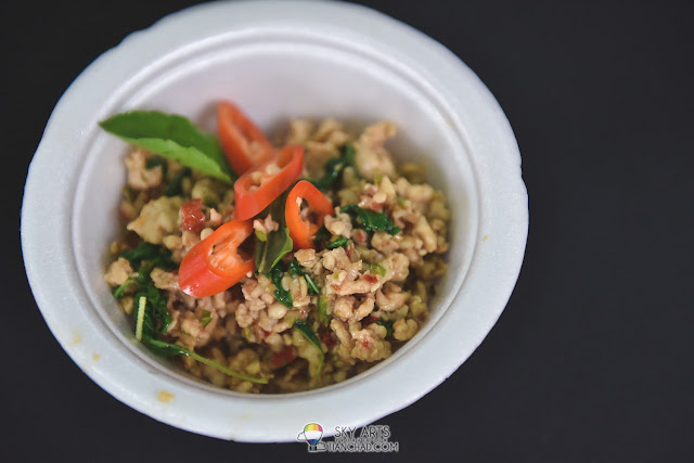 Tasty Gai Pad Krapaw(spicy stir-fried Thai basil chicken) is ready, best served with Thai white rice