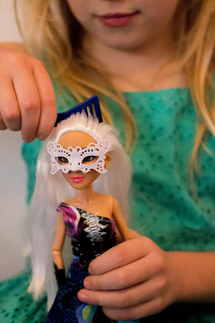 A close up of the Project Mc2 Camryn doll having her hair combed
