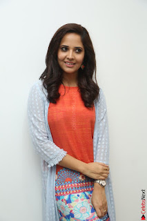Actress Anasuya Bharadwaj in Orange Short Dress Glam Pics at Winner Movie Press Meet February 2017 (87).JPG