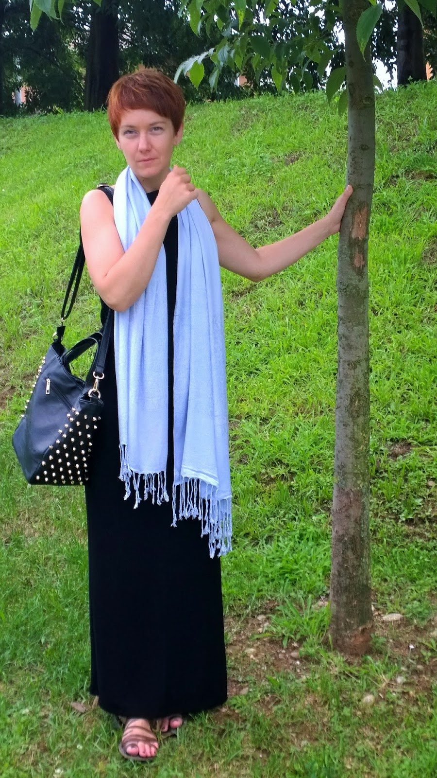 black maxi dress, blue scarf, studded bag and a tree