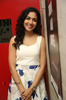 Actress Ritu Varma Stills in White Floral Short Dress at Kesava Movie Success Meet .COM 0127.JPG