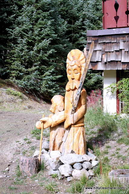 wooden statues at the taos ski valley