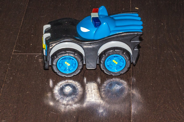 The Herodrive Batman Mash Machine Police Car preschooler toy and it's reflection