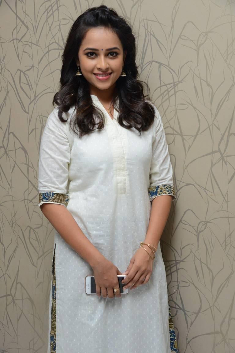 Actress Sri Divya Latest Stills In White Dress At Movie Success Meet