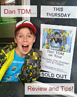 Excited boy in front of Dan TDM tour poster