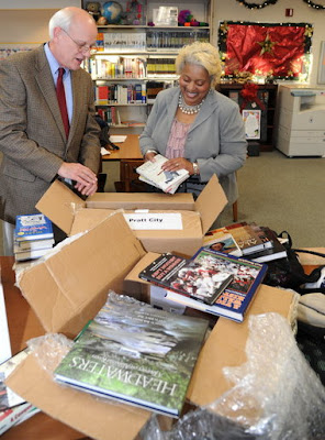 Donated books are sorted through at the Pratt City Library