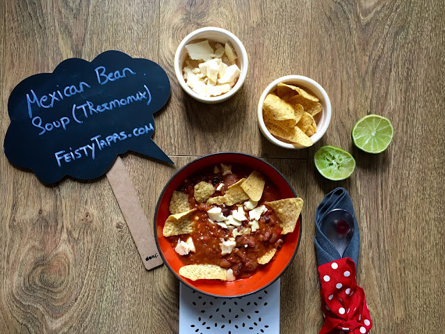 Julie's Thermomix Mexican Bean Soup served with tortilla chips, fresh lime wedges and wensleydale cheese