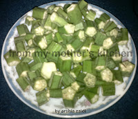 pieces of raw lady finger, kati hue bhindi