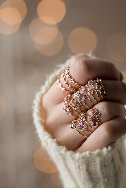 Melanie Casey's signature jewelry designs, Vine leaf bands and Cluster rings in 14k gold displayed on hand.