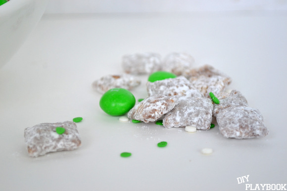 Peanut butter chocolate puppy chow with green M&Ms and white and green sprinkles