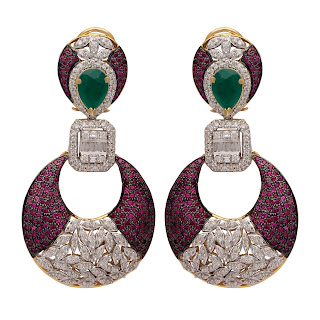 Exquisitely crafted Earrings in 18 K Gold finished in black polished tone and studded with Diamonds, Rubies and Emerald in the centre by Tanya Rastogi