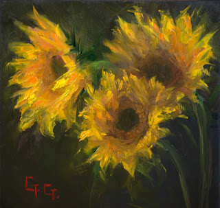 a small beautiful oil painting of sunflowers done with a palette knife on a cradled panel