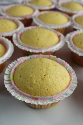 baked butter vanilla cupcakes in frilly liners